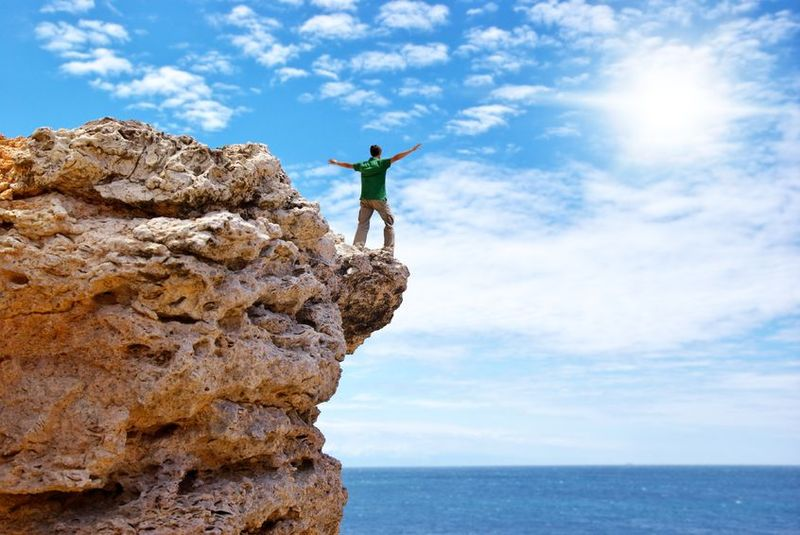 Man on cliff future