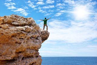 Man on cliff future